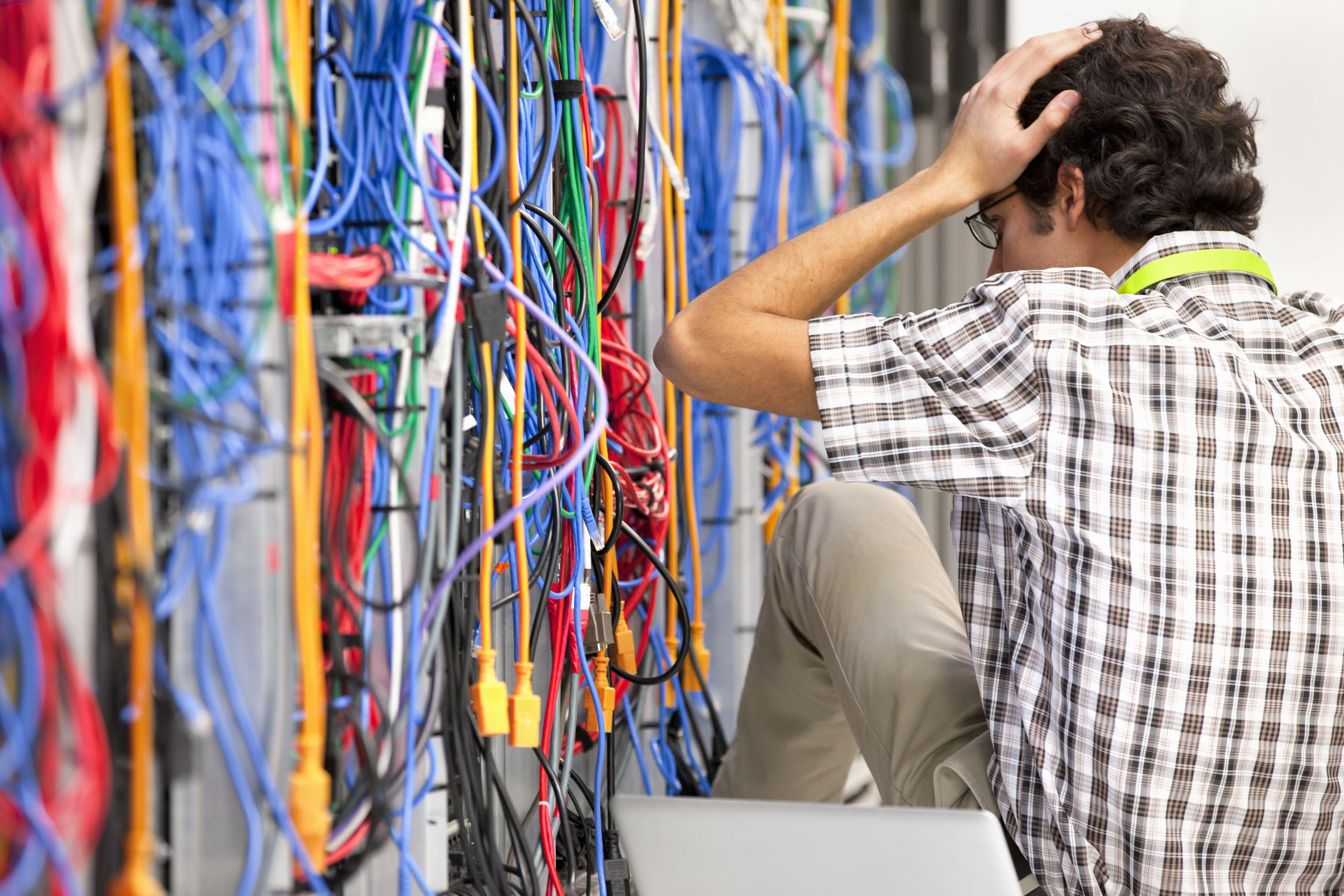 38023860 - frustrated technician working in server room of data center